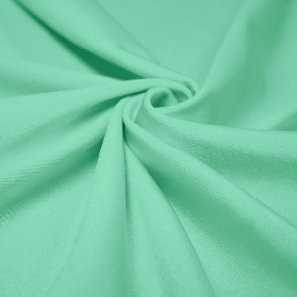 A swirled piece of shiny nylon spandex in menthol.