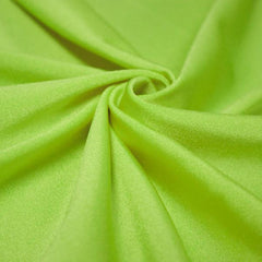 A swirled piece of shiny nylon spandex in neon lime.