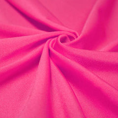 A swirled piece of shiny nylon spandex in neon pink.