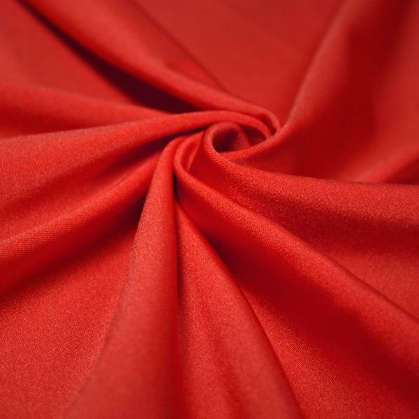 A swirled piece of shiny nylon spandex in red.