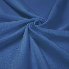 A swirled piece of shiny nylon spandex in royal.