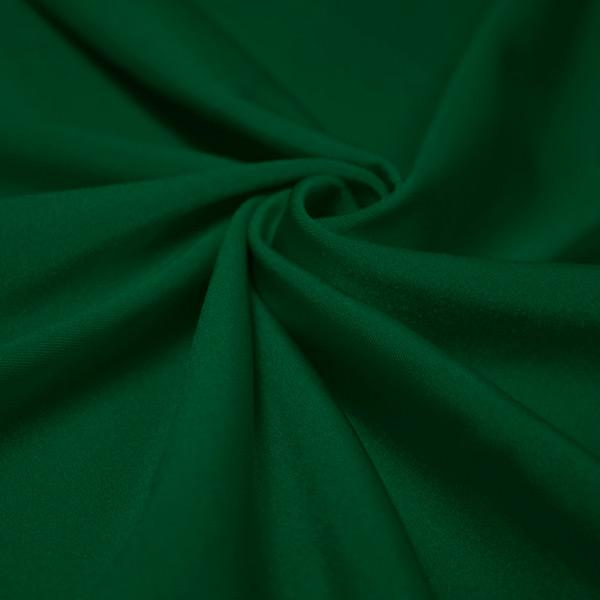 A swirled piece of shiny nylon spandex in sequoia.