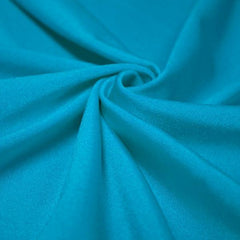 A swirled piece of shiny nylon spandex in turquoise.