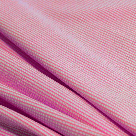 A rippled piece of stretch seersucker material in the color famous.