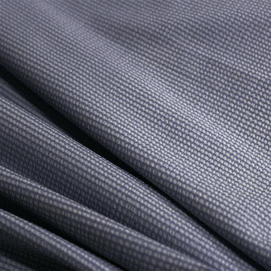 A rippled piece of stretch seersucker material in the color navy.