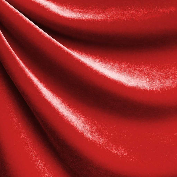 A drapped piece of Supreme Stretch Velvet in the color red.