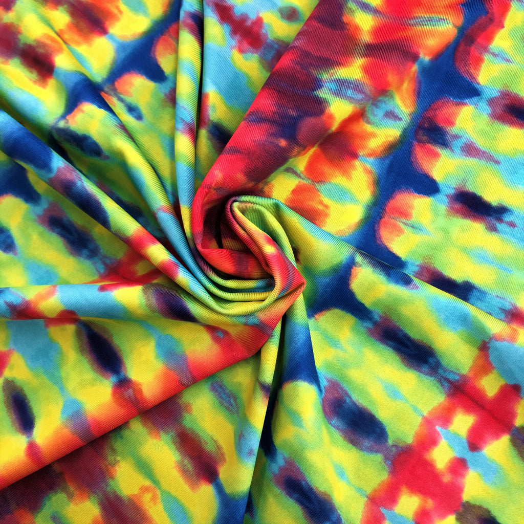 A swirled piece of double-sided tie-dye and stars polyester printed spandex.