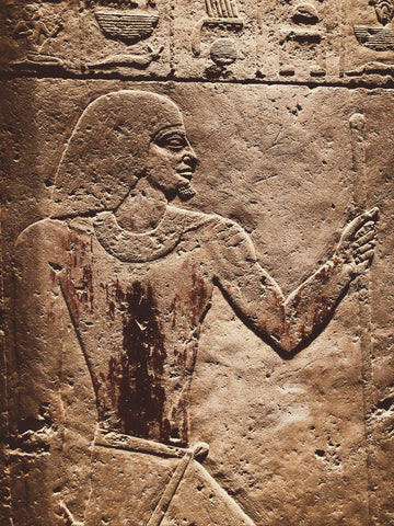 Ancient Egypt mural of man carved on wall