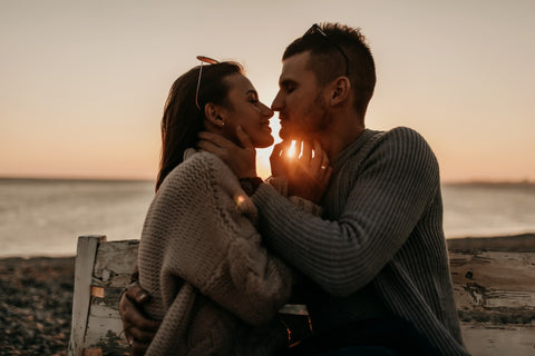 Couple on beach about to kiss