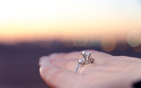 Parallel view of engagement ring on finger