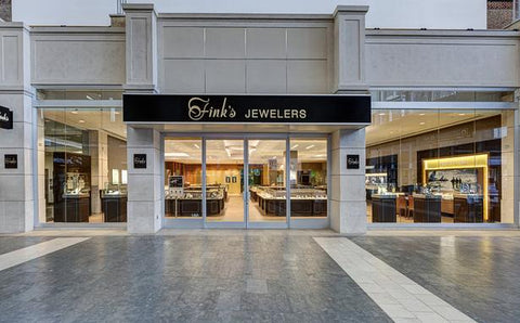 The front of Finks store that is concrete with large glass windows
