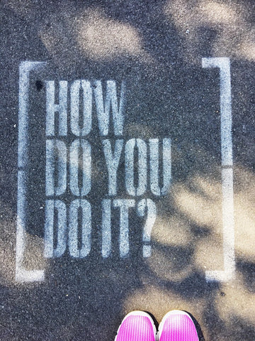"""""""how do you do it?"""" spray painted on pavement"""