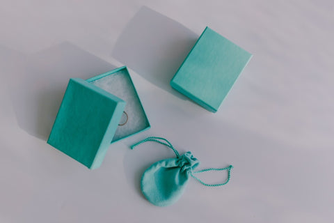 Light blue jewelry box, bag, and ring