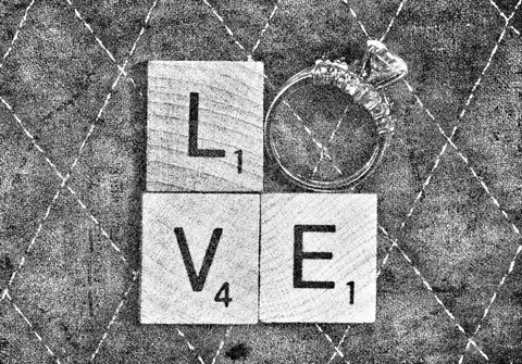"""Love spelt out with block letters and ring as the """"O"""""""