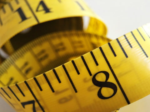 Close up of yellow flexible measuring tape