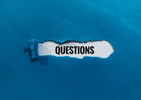 """""""Questions"""" under ripped piece of paper"""