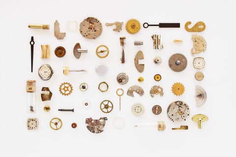 Scattered watch pieces forming a large rectangle