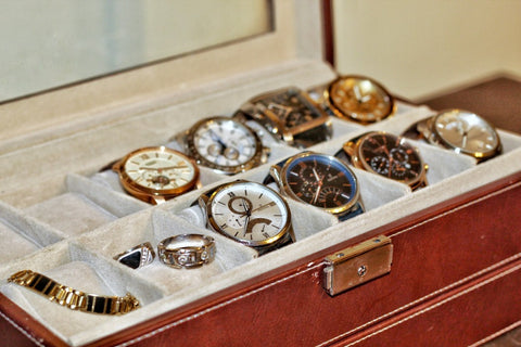 Watch jewelry box filled with two rows of watches