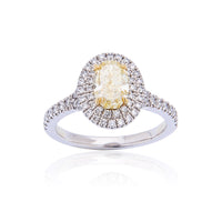 Fink's Exclusive Platinum and 18K Yellow Gold Fancy Yellow Oval Diamond and Round Diamond Engagement Ring