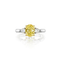 Fink's Exclusive Platinum and 18K Yellow Gold Fancy Yellow Oval Diamond and Pear Diamond Engagement Ring