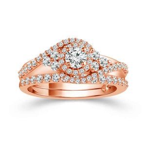 Fink's Exclusive Round Halo Engagement Ring Set with Twist Design