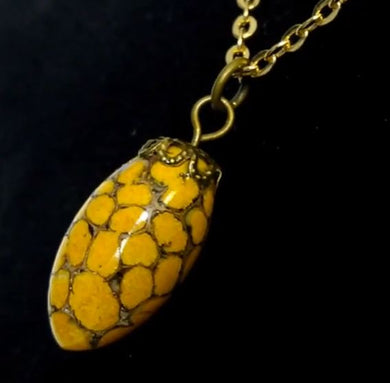 Pendant from Orpiment