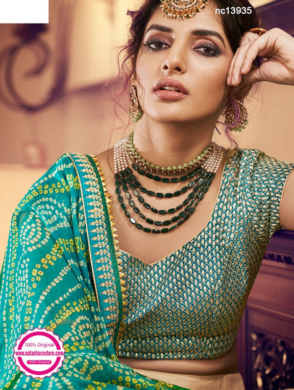 Cream & Green Net & Silk Lehenga Choli NC13935