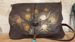 Brown leather bag with peacock feather design