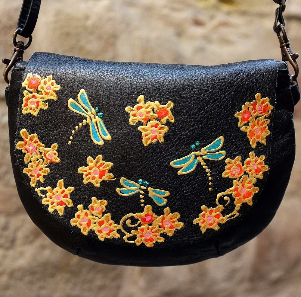 Small black leather bag with dragonfly design