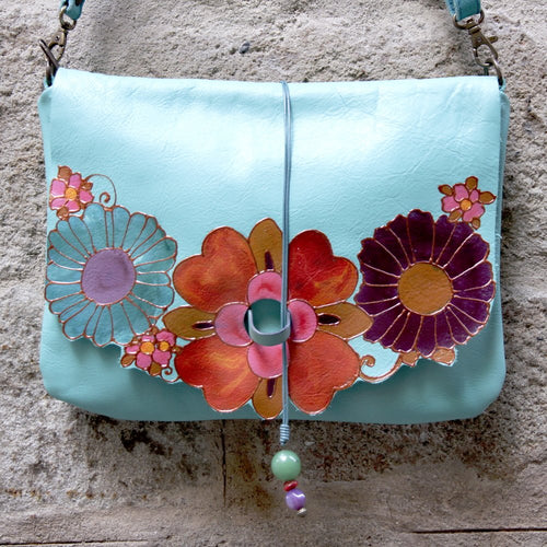 turquoise leather bag with mexican flowers design