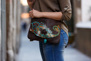 Large brown leather bag with paisley design