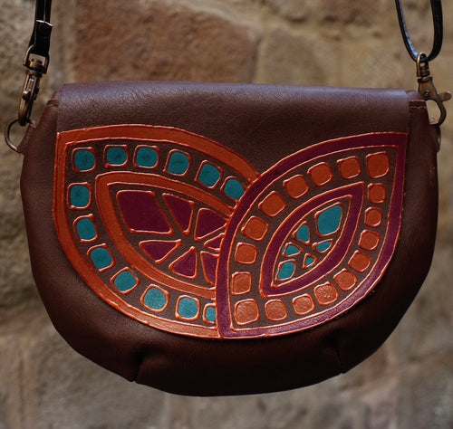 Small brown leather bag with melon design
