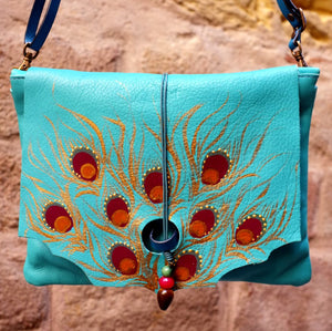 Medium size turquoise leather bag with peacock feather design