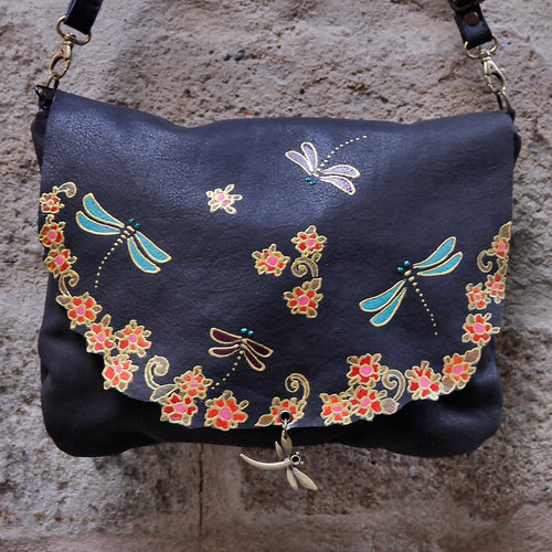 Large black leather bag with dragonfly design.