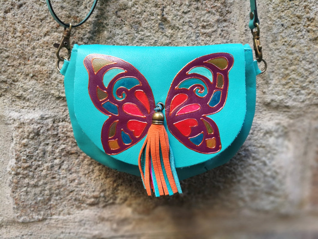 round leather bag with butterfly design