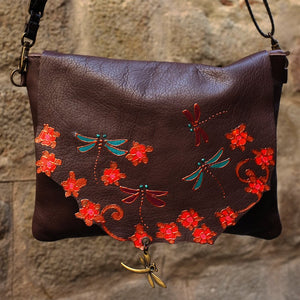 Medium size brown leather bag with dragonfly design