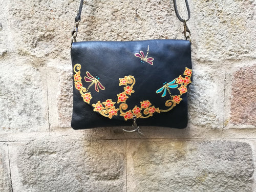 Black leather bag with dragonfly design