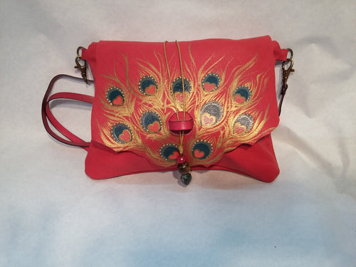 Medium size red leather bag with peacock feather design