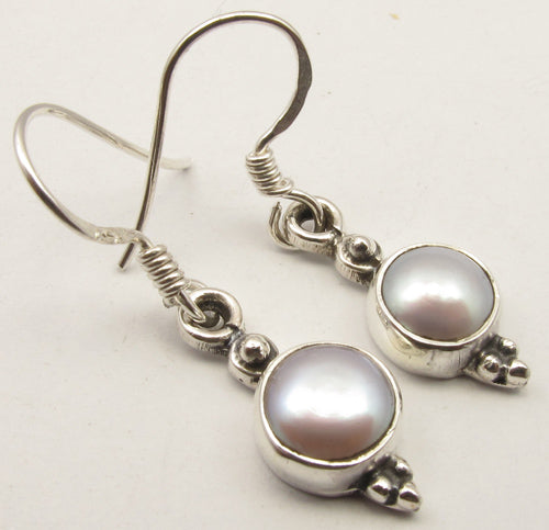 Silver Circle Drop Earrings at 'r a f t clothing'