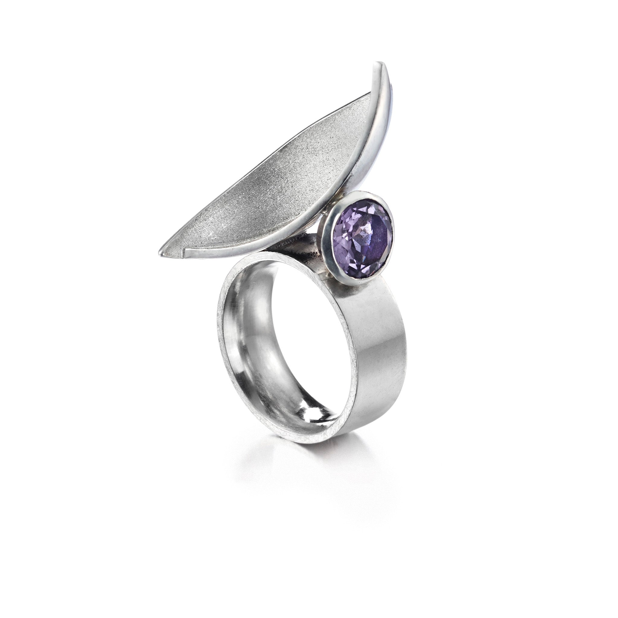 Heavy architectural sterling silver ring with faceted amethyst.