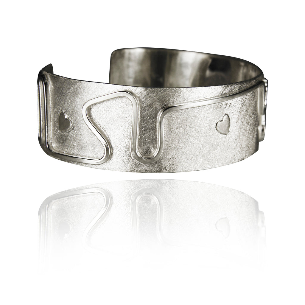 Ornamental sterling silver cuff.