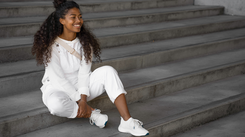 Model on stairs wearing Vessi's latest 100% waterproof sneaker style, the Everyday Move