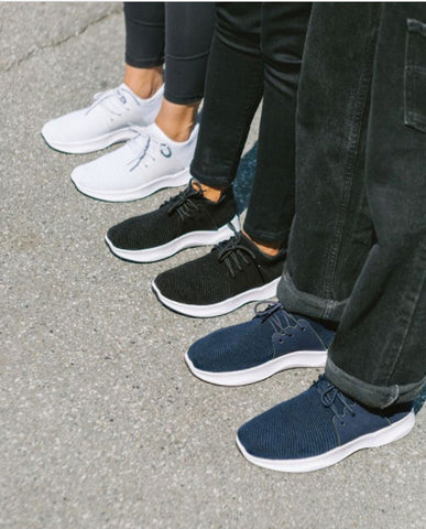 Image of three people's lower bodies with different pairs of Vessi shoes on