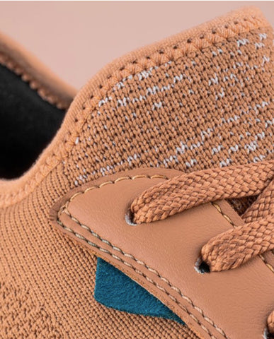 A close-up image of the Vessi Weekend eco-friendly sneakers displaying the unique waterproof material