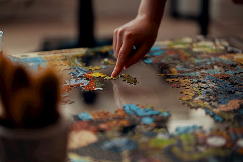 Someone putting together a puzzle on their staycation