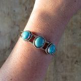 Fox turquoise and sterling silver cuff bracelet on arm
