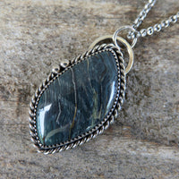 Blue petrified bog wood pendant