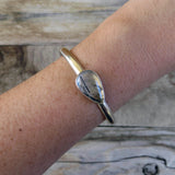 Tourmalinated quartz and sterling silver cuff bracelet on arm