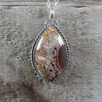 Mexican crazy lace agate and sterling silver pendant