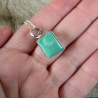 Lucin variscite and sterling silver pendant on hand